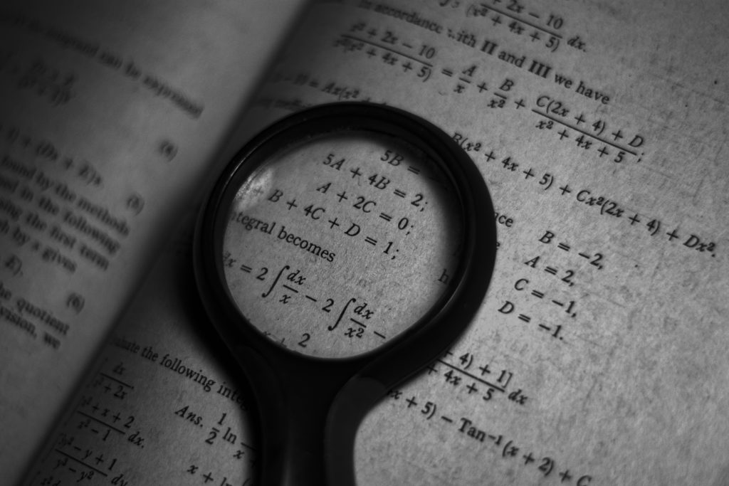 Magnifying glass on maths formula